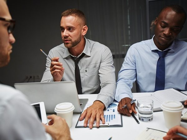 Group of creative people consulting at late meeting